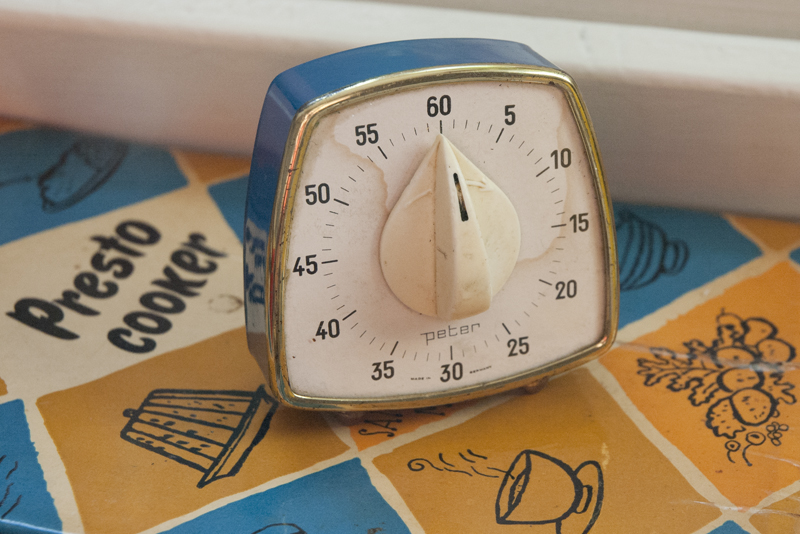 Vintage egg timer on a presto cooker book