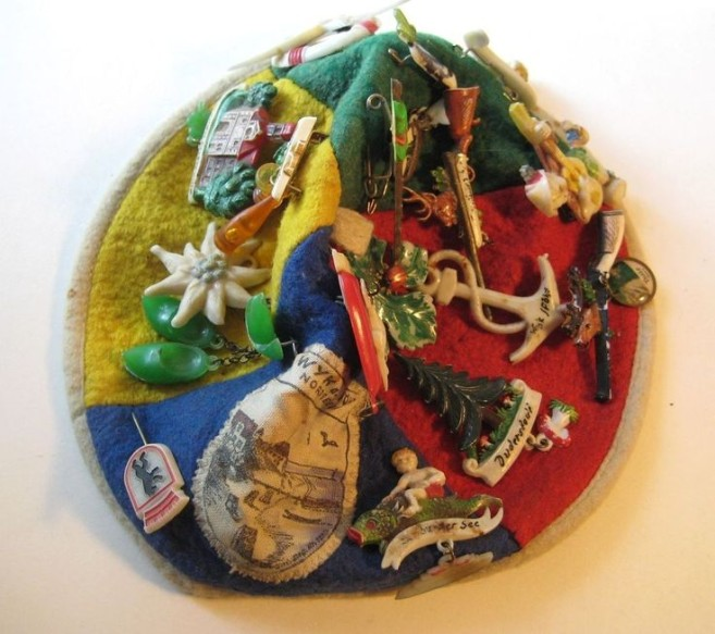 tourist hat filled with vintage broches